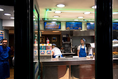 Waiting (votsek) Tags: 2016 scotland argylestreet glasgowcentral storefront store shop restaurant glasgow people workers