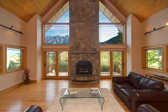 View (Whistler Whatever) Tags: livingroom high ceiling realestate green vaulted forest trees view home symmetrical windows mountain house tokinaatx116prodxaf1116mmf28 pemberton bc canada fireplace stone wood