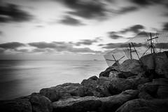 Intermediate (Alex E. Milkis) Tags: sea ashdod israel nd d7100 18140 longexposure bw sunset evening shore rocks fence sky dark vignette water outdoor tripod