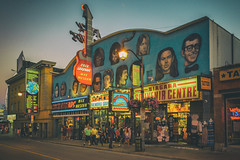 Rock Legends (A Great Capture) Tags: niagarafalls street streetphotography night dusk people walk walking guitar legends wax museum sign signs rocknroll rock roll niagara falls agreatcapture agc wwwagreatcapturecom adjm on ontario canada canadian photographer northamerica ash2276 ashleylduffus ald mobilejay jamesmitchell summer summertime 2016 city downtown lights urban dark nighttime cityscape urbanscape eos digital colours colors