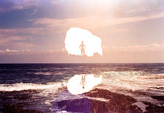 In Two (Hayden_Williams) Tags: cave hole silhouette light shadow girl figure person reflection water ocean sea waves shore sky clouds blue doubleexposure multipleexposure film analog analogue canonae1 fd50mmf18 kodakportra400
