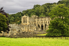 Rievaux (maureen bracewell) Tags: england uk clouds countryside farming hills landscape rural summer rievaulx abbey ruin historic mellow stone architecture helmsley cistercians religion monks romantic trees nature northyorkshire fields maureenbracewell monastery