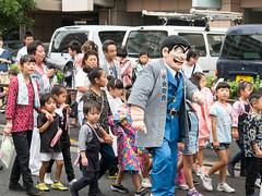 Homegrown (H.H. Mahal Alysheba) Tags: japan snapshot street parade tokyo comic gx7 leicadg elmarit 45mmf28