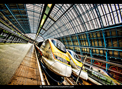 Eurostar to Paris (Edwinjones) Tags: city uk travel roof light england urban london glass lines station metal architecture modern train europe eurostar curves gothic perspective victorian railway trains terminal line trainstation stpancras hdr highdynamicrange stpancrasstation londonstpancras highspeed1