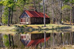 """Cabin Reflections"" Sleeping Bear Dunes National Lakeshore (Michigan Nut) Tags: old trees usa lake building nature water pine forest reflections reeds photography spring pond woods michigan cottage historic lodge logcabin homestead sleepingbeardunes oldcabin secluded primitive m22 nikonafs70300mmf4556vr michigannutphotography"