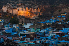 Blue Bundi (Alex Treadway) Tags: city blue houses sky india history architecture outdoors evening town twilight asia rooftops hill tranquility nopeople palace lit hillside fortress turret thepast scenics rajasthan crowded populated buidings litup floodlights bundi traveldestinations bundipalace builtuparea buildingexterior surroundingwall bluebuildings builtstructure historicbuiding traditionallyindian populatedarea