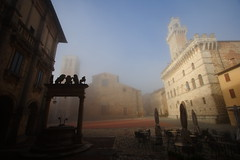 Montepulciano ((:Andrzej:)) Tags: old city morning italy film misty fog square restaurant twilight europe empty nopeople tuscany townhall piazza montepulciano toscana umbrellas openair rynek poranek twighlight blusky miasto mga parasole plac niebieskie niebo ratusz toskania theworldwelivein zmierzch studnia stoliki morningemptyplac