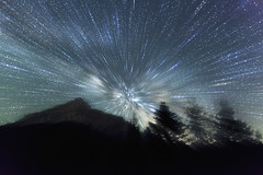 Supernova [explored 19th June 2012] (ChrisBrn) Tags: sky mountain night stars silhouettes peak nightsky spruce startrails