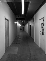 Studio Building Hall (My TVC 15) Tags: light shadow blackandwhite ontario building london texture lines wall dark grit concrete grey hall doors angle perspective angles hallway dc2 artstudios panasonic14mmf25 olympusomdem5 studiobuildinghall