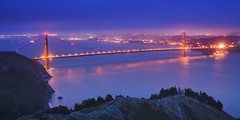 """Golden Gate"" (M. Shaw) Tags: ocean sanfrancisco california lighting longexposure bridge sunset sea reflection building history water fog skyline architecture clouds canon lights downtown ship cityscape historic goldengatebridge baybridge bayarea tugboat artdeco lighttrails bluehour sausalito beacon californiacoast crissyfield fortbaker cloudynight 1635mmf28l conzelmanroad mshaw 5dmark2 canoneos5dmarkll 2x1crop"