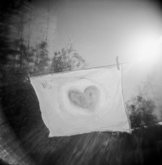 heart art drying up in the wind, santa cruz, june 2012 [#023802o] (Jeff Merlet Photography) Tags: california ca family sky blackandwhite bw usa santacruz sun art 120 film analog painting square holga paint published heart wind toycamera fabric 02 hp5 ilford 2012 120n hp5plus rpl clothline 201206 scphoto analogphotgraphy journeyofanorcalfamily jeffmerletphotography jeffmerlet photojeffmerletcom r0238 rpl0034 023802 hamsamerlet
