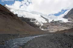 Glacial Melt (vividcorvid) Tags: china sky mountain snow ice water clouds river landscape frozen asia stream places tibet glacier riverbed melt himalayas karolaglacier norinkang