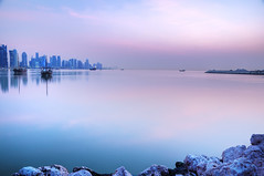 Good Morning Doha! (Wajahat Mahmood) Tags: morning pink blue sea beach skyline sunrise buildings dawn day cloudy redsea middleeast corniche getty hdr highdynamicrange doha qatar dhow