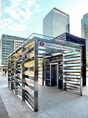 lift to canary wharf station (Harry Halibut) Tags: blue sky london sunshine station underground lift steel elevator transport tube entrance wharf trust canary woven northern stainless allrightsreserved tfi londonbuildings londonarchitecture buildiing interleaved anglesanglesangles colourbysoftwarelaziness 2012andrewpettigrew london1207062390