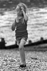 Girl on the beach (CanonGirl101) Tags: sea beach canon pose person eos child serious candid beachlife pebbles groyne tezz canonef100400mmf4556lisusm tezz5d2