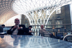 Kings Cross station (Che-burashka) Tags: street people london architecture cafe candid tables kingscross omd 1250 em5 olympus1250mmf3563