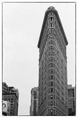 Flatiron Building - NYC (gastwa) Tags: nikon f6 afs nikkor 58mm f14g prime ilford hp5 plus film analog black white blackandwhite bw monochrome scenery landscape newyork nyc travel andrew gastwirth andrewgastwirth structure flatiron building architecture street bokeh