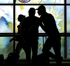 Travelers II (martina.stang) Tags: silhouette street people candid ariport travelling travelers colorful background