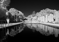 Lady walking along pool DSC_5342 (Bruce_of_Oz) Tags: filoli gardens pool digital infrared reflection