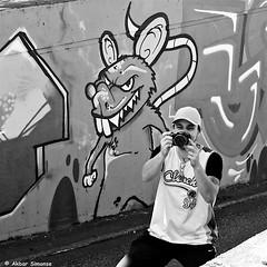 DSCN3659 (Akbar Simonse) Tags: dscn3659 netherlands nederland holland photograper camera fotograaf graffiti streetart rat people straatfotografie streetphotography akbarsimonse zwartwit bw blancoynegro bn monochrome cap pet