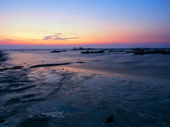 Evening glow (Ted Tsang) Tags: olympus em1 1240mmf28 nd106 sunset longexposure wetlands beach wave sky boat ship silhouettes taiwan lugang chunghua reflections bluehour magichour night nightscape sea seascape twilight