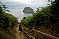 The adventure starts here (Daniel Nebreda Lucea) Tags: adventure aventura landscape paisaje nature naturaleza spain espaa canon mountain montaa sea mar ocean oceano travel viajar sky cielo clouds nubes water agua rock roca girl chica people gente gaztelugatxe euskadi north norte wildlife salvaje earth tierra