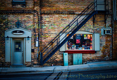 A coloured past  (HSS) (13skies) Tags: happyslidersunday topaz software topazsoftware shop shoparoundthecorner small coloured bricks sonyalpha99 window fireescape stairs door things sunday slidersunday colors colours road pipes frames signs ac electricallines conduit railing
