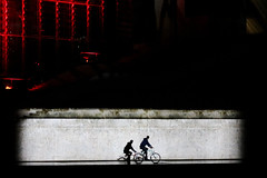 cold war (Wackelaugen) Tags: cyclist man bycicle cycle wall berlin projection multimediashow bundestag silhouette texture canon eos photo photography wackelaugen googlies