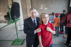 Jean Todt with a child on Day 1 of the Summit