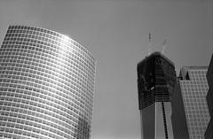 Buildings (missiletest) Tags: nyc newyorkcity sky blackandwhite bw newyork film glass architecture 35mm buildings skyscrapers manhattan rangefinder 35mmfilm fed2 grayscale fed greyscale goldmansachstower 53mm oneworldtrade 200weststreet