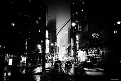 little lights in clouds (Nassia Kapa) Tags: street nyc newyorkcity light urban blackandwhite bw ny newyork rain night clouds dark lights noir shadows streetphotography timessquare nn streetsofnewyork nassiakapa