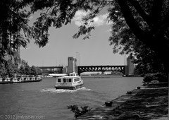 Giddy Up (Jim Frazier) Tags: park city trip travel bridge trees summer vacation urban blackandwhite bw chicago tourism nature water monochrome up june architecture canon buildings river boats boat illinois marine scenery wake cityscape tour riverside meetup ships scenic cook structures bank sunny tourists powershot architectural il maritime transportation frame infrastructure drawbridge desaturated riverfront nautical framing traveling riverbank tours touring riverwalk giddy cookcounty 2012 riparian lightroom wscf chicagoriverbridges s95 westsuburbanchicagoflickrers ldjune jimfraziercom ld2012 20120602beeyouteefulchicago desaturatedbw