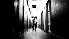 Solo / Alone (Hernan Piera) Tags: white man black blancoynegro photography photo hoodie kid loneliness foto photographer image pic aisle diver soledad sweatshirt fotografia pibe pasillo hombre imagen fotografo capucha buzo sudadera hernanpiera agustinroman