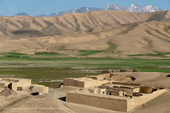 A small village in the Bamiyan province with views of distant mountains (Alex Treadway) Tags: sky terrain house mountain afghanistan mountains colour building green field horizontal rural landscape asian outside outdoors photography asia day village open farm space traditional farming middleeast meadow dry ground bluesky hills growth pasture valley fields remote growing agriculture plains barren arid naturalworld himalayas slope grasslands scenics settlement distant bamiyan vast mountainrange expanse mudhouse himalayanrange ruralscene beautyinnature buildingexterior extremeterrain dramaticlandscape distantmountains dusttrack bamiyanprovince builtstructures rangelands