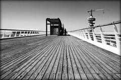 Pier of Scheveningen (macushla63) Tags: white black pier boulevard scheveningen denhaag hague promenade zwart wit