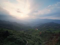 Sunrise at Longji Rice Terrace (claying) Tags: olympus em5 kowa prominar85mmf28 china guangxi guilin longsheng longji dragonsback panoramahousehotel sunrise rice terrace