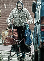 EVERY PICTURE TELLS A STORY (IAN GARDNER PHOTOGRAPHY) Tags: fragile old scared immobile woman public humiliation help coventry nasty harsh baglady untidy needy ngc
