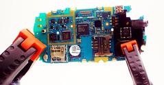 a peek inside... (www.yashicasailorboy.com) Tags: circuts closeup studio electronics ngc board clamps smartphone