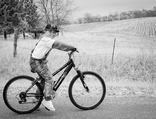 Farm kid on a bike