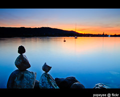 Zurich Lake (Popeyee) Tags: blue sunset lake golden switzerland stones zurich hour