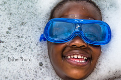 Boy in the Bubbles (ckfishel2001) Tags: blue boy portrait smile kids fun bath faces may bubbles speedo suds 2012 youngboy swimgoggles nikon18200mm nikond7000 fishelphoto