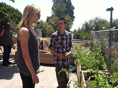 Emily VanCamp gets a lesson from a student gardener