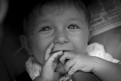 Laughing Stefano (Terry Moran Photography) Tags: bw baby white lake black blur cute beautiful face smiling laughing dark lago happy 50mm eyes nikon garda dof child bokeh head young dummy staring pupil sirmione d3100