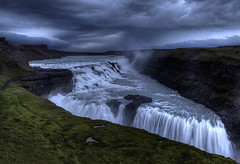 Golden Falls (murphyz) Tags: travel cloud mountains water grass river landscape photography golden waterfall iceland dramatic tourist falls spray staircase midnight gullfoss current attractions cataract 2012 crevice plunge tiered goldencircle hvt murphyz