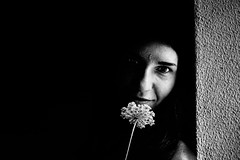 Smell my flower (Vitor Pina) Tags: portraits photography pretoebranco people portrait portait pessoas contrast candid light shadows blackandwhite monochrome momentos mulher moments woman