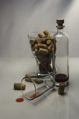 Still life with glass items and wine corks (Alexander Pugatschewski) Tags: still object cork glass background light bottle bowl brand wine drop red lettering drawing uneven slick reflection shadow transparent inverted lens exakta