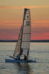 Calm Sailing (TimeTraveller37) Tags: sailing boat sail people cowes isleofwight westcowes calm serene sunset sundown water sea seascape red redskies peace peaceful uk sails canon7d 70200mm composition perspective beauty hot