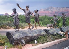statue in sedona (just me julie) Tags: trees arizona dog mountains statue kids children log rocks day cloudy sedona redrock