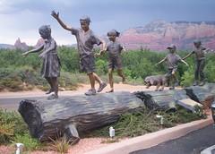 statue in sedona (just me julie) Tags: trees arizona dog mountains statue kids children log rocks day cloudy sedona redrock