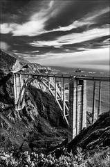 The Bixby Creek Bridge (Martin Smith - Having the Time of my Life) Tags: ocean california bridge bw usa monochrome monterey nikon bigsur breakers bixbycreekbridge arched cabrillohighway nikon18200vr d7000 pse9 adobelightroom4